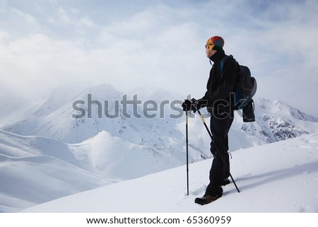 A man looks at the view a winter mountains