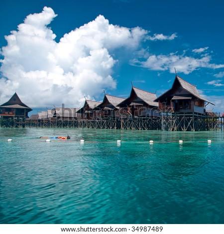 A man-made Kapalai island with exotic tropical resort - stock photo