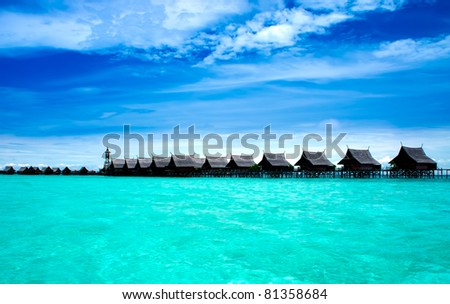 A man-made Kapalai island with exotic tropical resort - stock photo