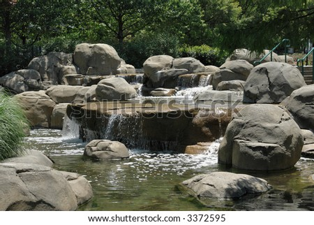 A man made oasis in a park in downtown Atlanta, Georgia. - stock photo