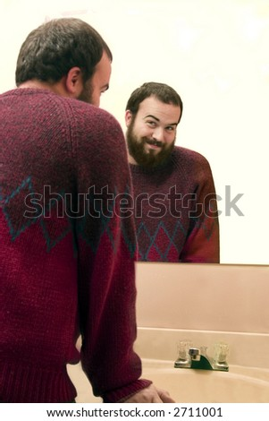 a man making flirty eyes in a mirrors