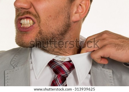 a man (manager) feels concentrated. the collar bursts. - stock photo