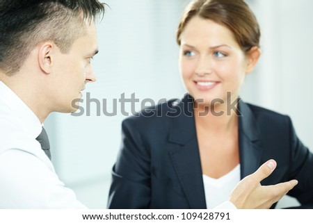 A man manager looking at business partner during conversation - stock photo