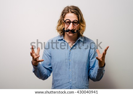 a man of a fake nose and glasses, with mustache and furry eyebrows - stock photo