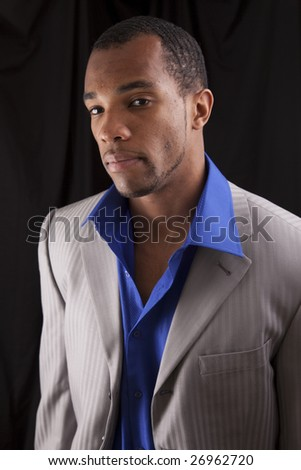 A man of african descent dressed casually for a night out on the town