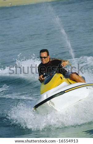 A man on a jet ski - stock photo