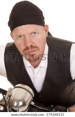 A man on a motorcycle close up shot of head. - stock photo