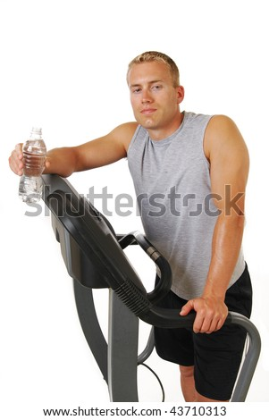 A man on a treadmill with a bottle of water - stock photo