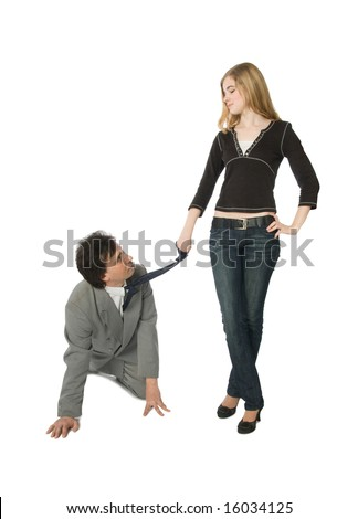 A man on all fours and a young woman pulling him by a necktie - stock photo