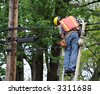 A man on ladder working on the power lines. - stock photo