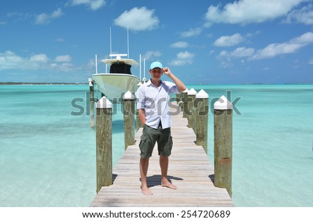 A man on the wooden jetty. Great Exuma, Bahamas - stock photo