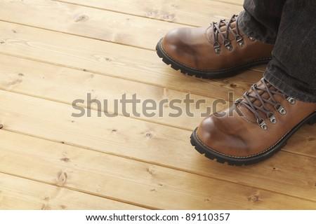 A man on wooden floor - stock photo
