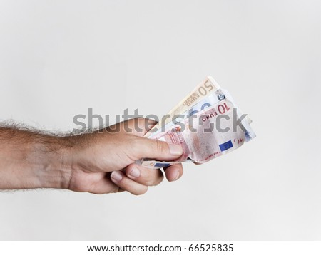 a man paying his debts with euro banknotes