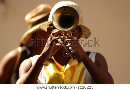 A man playing a trumpet on the streets of Havana, Havana, Cuba