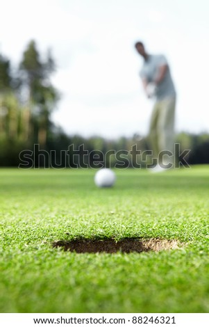A man playing golf - stock photo