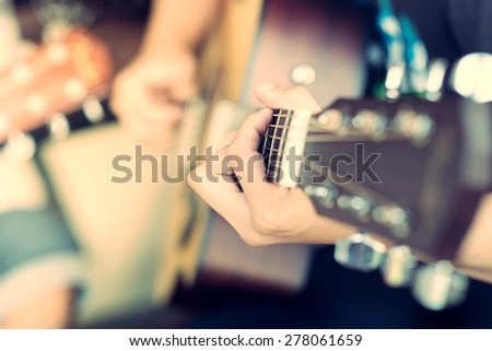 A man playing guitar,Vintage effect - stock photo