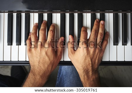 a man playing the piano - stock photo