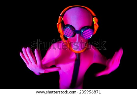 a man poses inside a pink UV glow suit - stock photo