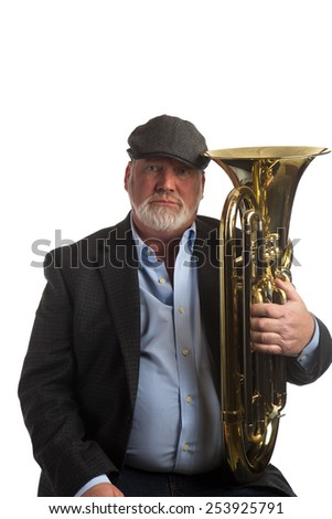 a man posing with a Euphonium, or tenor tuba, isolated on a white background  - stock photo