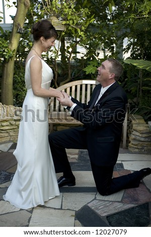A man proposes to his future wife - stock photo