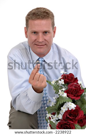 A man proposing with a ring and flowers