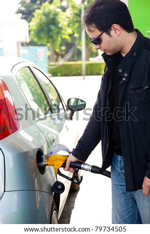 A man pumping diesel in to the tank - stock photo