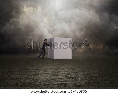 A man pushing a box - difficulties and determination concept - stock photo