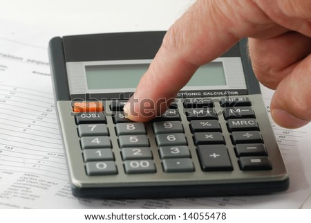 A man put on the key of calculator