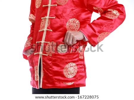 A man putting chinese cash gift in his pocket  - stock photo