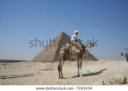 A man riding a camel in Pyramid area in Egypt - stock photo