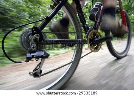 A man riding his mountain bike - stock photo
