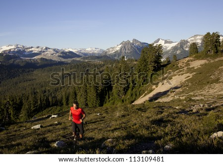 A man runs in Garibaldi Park, near Whistler, British Columbia, Canada. - stock photo