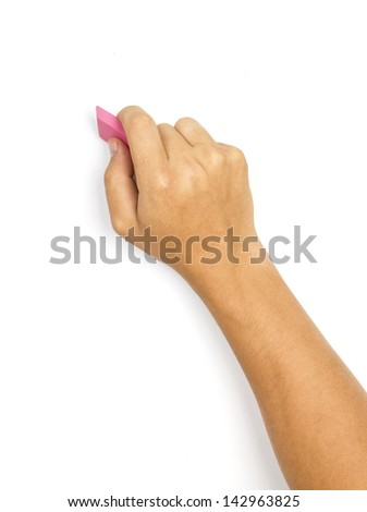 A man's hand erasing something on white background - stock photo