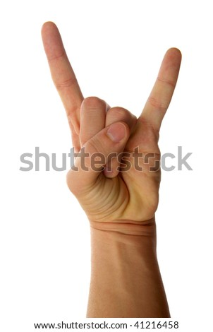 A man's hand giving the Rock and Roll sign. - stock photo