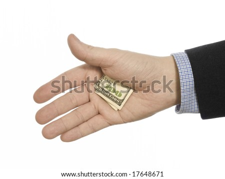 A man's hand hiding a hundred dollars tip. - stock photo