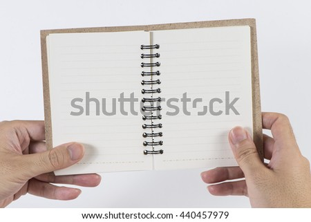 A man's hand hold the blank notebook  - stock photo