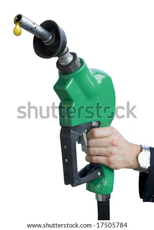 A man's hand holding a dripping gas pump - stock photo