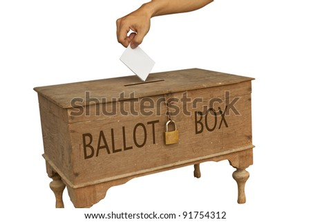 A man's hand putting an envelope in the slot of a box - stock photo