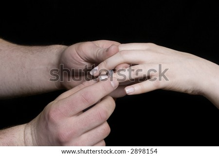 a man's hands putting on proposal