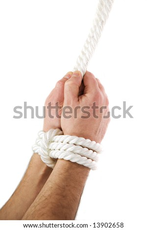 A man's hands tied of white rope - stock photo