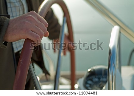 a man sailing with a rudder helm - stock photo