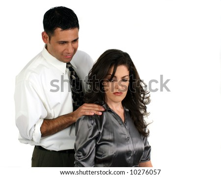 A man sexually harassing a coworker - stock photo