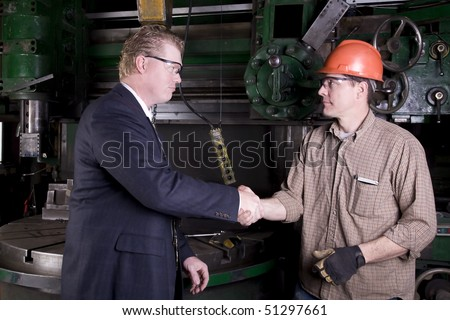 A man shaking hands with his boss.