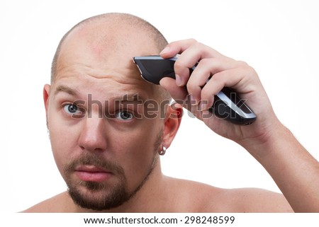 a man shaves his head - stock photo
