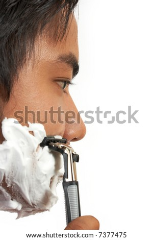 a man shaving over a white background - stock photo