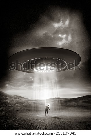 A man shields his eyes from the bright UFO above him.  - stock photo