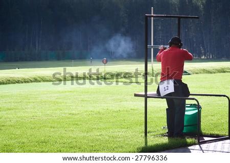 A man shooting - stock photo