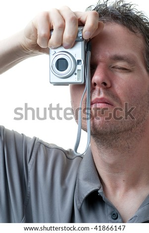 A man shooting with a small digital camera, isolated on white. - stock photo