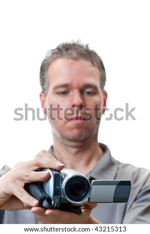 A man shooting with a video camera, focus on the video camera, isolated on white. - stock photo