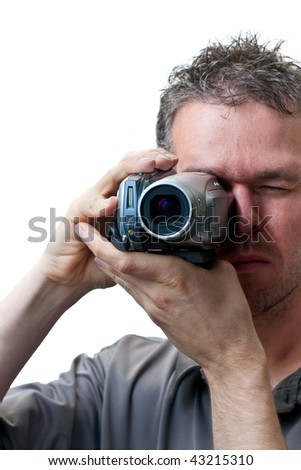A man shooting with a video camera,  isolated on white. - stock photo